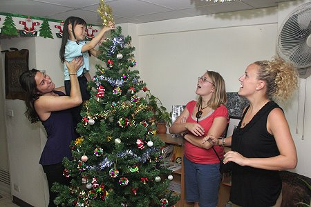 nong grace has been badgering me for several months to bring out the christmas tree and to put up the decorations last year was her first christmas - People Decorating A Christmas Tree